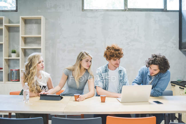 Co-workers working in open plan office together — Stock Photo