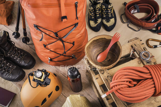 Top view of prepared climbing equipment with rucksack, climbing boots and climbing rope — Stock Photo