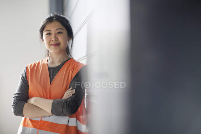 Portrait of female technician in factory — Stock Photo