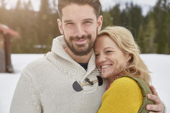 Portrait of couple in snow, Elmau, Bavaria, Germany — Stock Photo