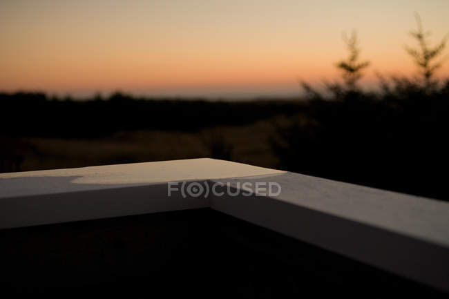Close-up view of empty balcony corner and blurred natural background, selective focus — Stock Photo