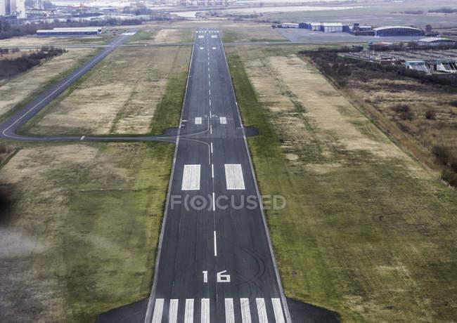 Aerial view of aphalt airport runway — Stock Photo