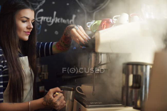Barista making coffee in cafe — Stock Photo