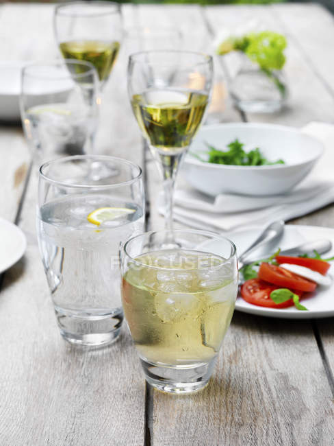 Food and drink on table at summer garden party — Stock Photo