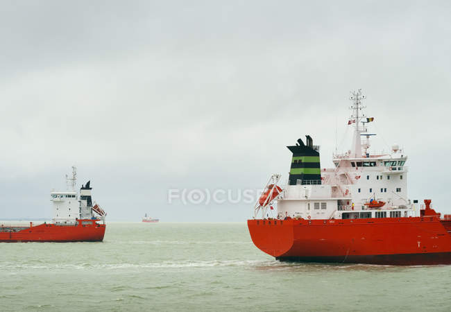 Ships with red hull pass each other on the North Sea — Stock Photo