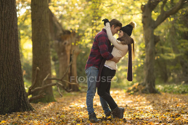 Young couple in forest, embracing — Stock Photo