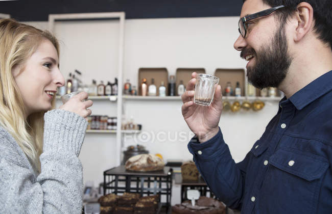 Couple drinking espresso in cafe together — стокове фото