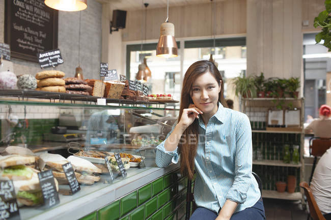 Portrait of mid adult woman in cafe — Stock Photo