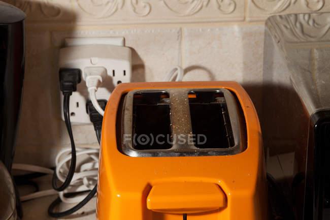 Close up of Orange toaster on table — Stock Photo