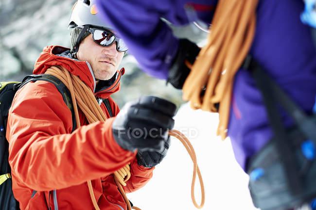 Mountaineers preparing climbing equipment — Stock Photo