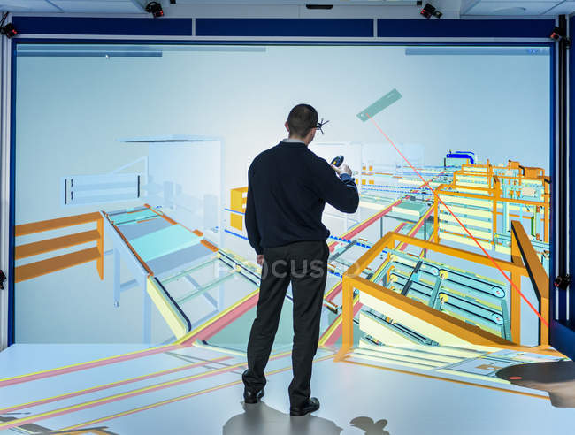 Engineer inspecting factory layout in 3D in virtual reality suite — Stock Photo