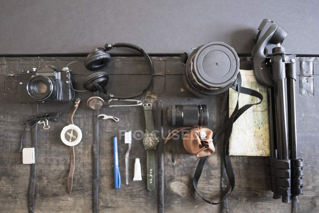 Top view of camera, accessories and tripod — Stock Photo