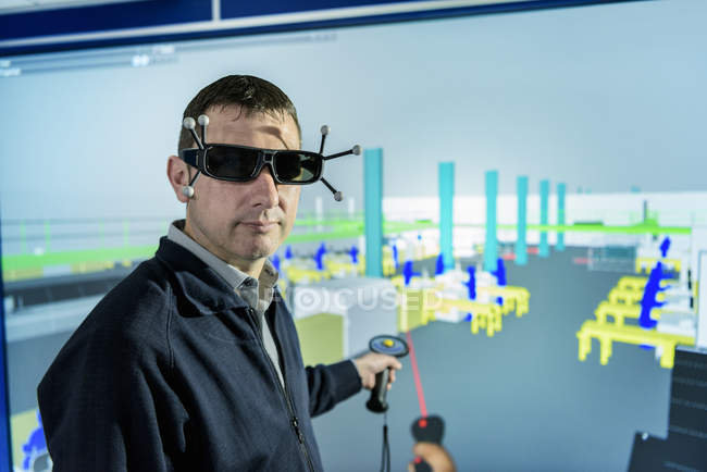 Portrait of engineer with factory graphic in 3D in virtual reality suite — стокове фото