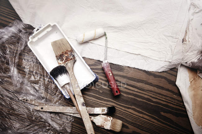 Still life of paint brushes and paint roller, top view — Stock Photo