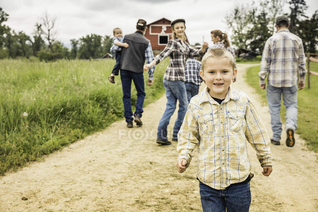 Boys on dirt track looking at camera smiling — Stock Photo