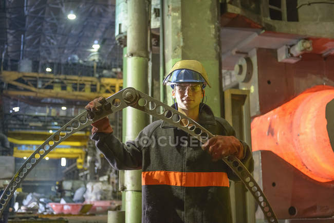 Portrait of apprentice steelworker in industrial factory — Stock Photo