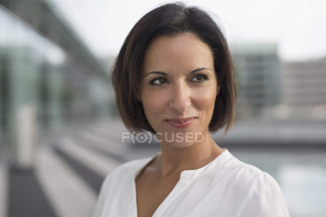 Portrait of mature businesswoman outside  airport — Stock Photo