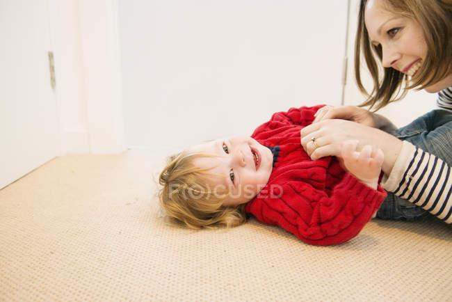 Mother tickling son, selective focus — Stock Photo