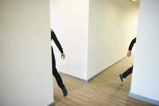 People walking across corridor — Stock Photo