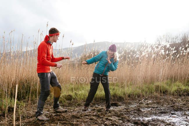 Young couple hiking, fooling around, Derwent Water, Keswick, Lake District, Cumbria, United Kingdom — Stock Photo