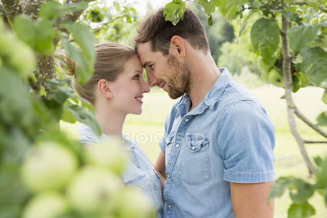 Mid adult couple face to face — Stock Photo