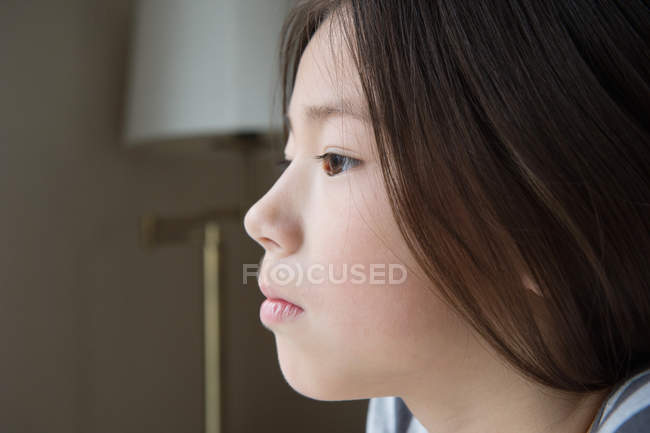 Close up portrait of serious asian girl — Stock Photo