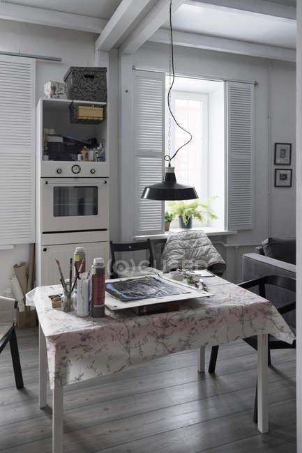 Room interior, artist materials on table — Stock Photo