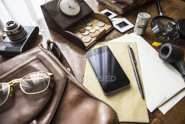 Still life of group of vintage objects with smartphone — Stock Photo