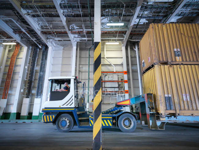 Container truck inside industrial cargo ship hold — Stock Photo