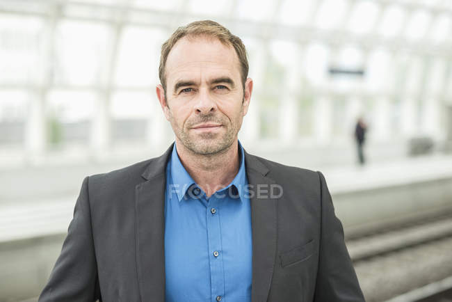 Portrait of mature man wearing jacket and looking at camera — Stock Photo