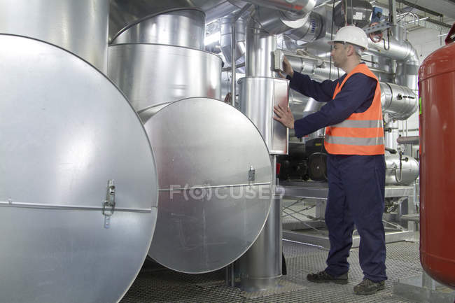 Technician monitoring pipes in power station — Stock Photo