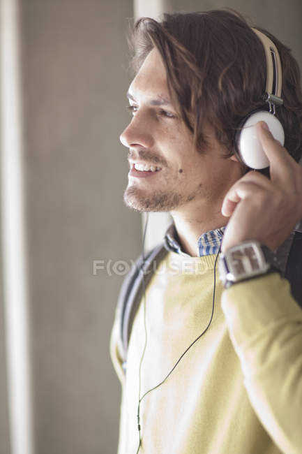 Close-up of mid adult man listening to music on headphones — Stock Photo