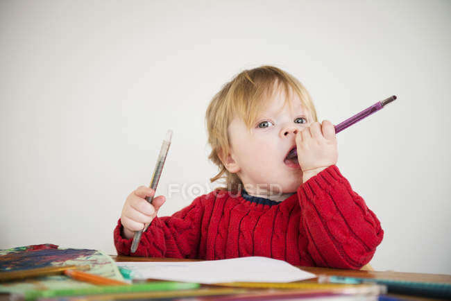 Boy holding colouring pencils — Stock Photo