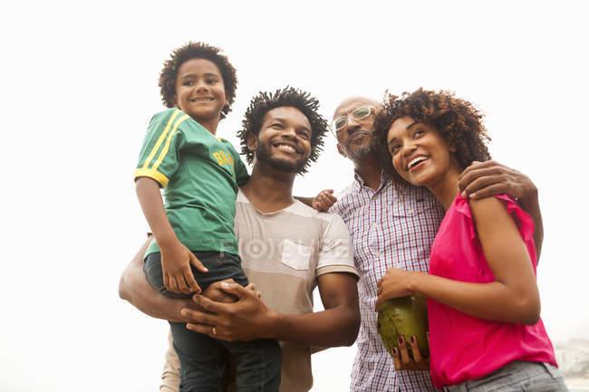 Low angle view of family of four on Ipanema beach, Rio De Janeiro, Brazil — Stock Photo