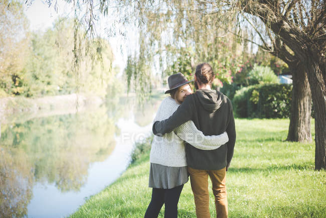 Young couple on riverbank, Dolo, Venice, Italy — Stock Photo