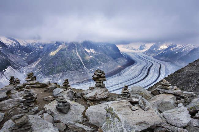 Stacks of stones on top of boulders, Eggishorn, Switzerland — Stock Photo