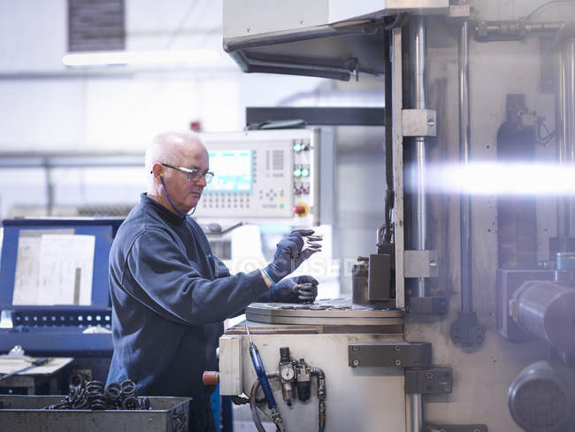 Engineer making automotive spring in automobile parts factory — Stock Photo