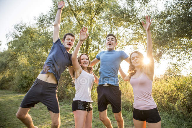 Portrait of group of friends in rural environment, fooling around, smiling — Stock Photo