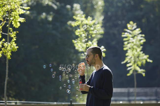 Man blowing bubbles, Valle de Aran, Spain — Stock Photo