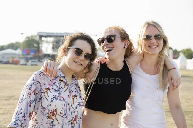 Portrait of three female friends at festival — Stock Photo