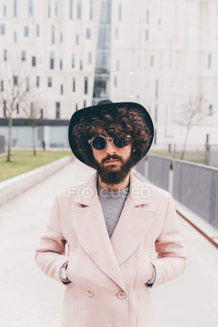 Portrait of young man, hands in pockets, in urban environment — Stock Photo