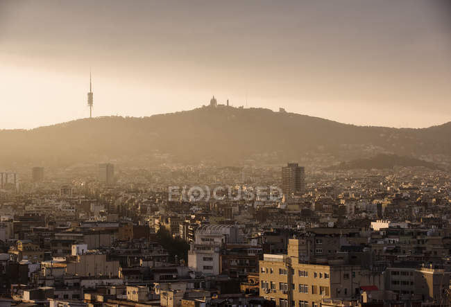 Elevated cityscape view to Tibidabo from Montjuic, Barcelona, Spain — Stock Photo