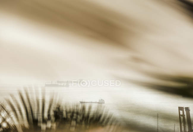 Blurred view toward distant ships at sea, Barcelona, Spain — Stock Photo