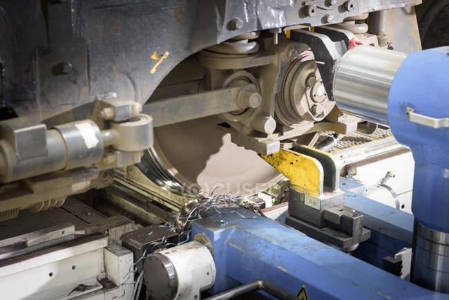 Detail of locomotive wheel lathe in train works — Stock Photo