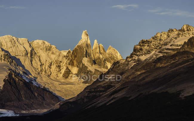 View of Cerro Torre mountain range against blue sky, Los Glaciares National Park, Patagonia, Argentina — Stock Photo