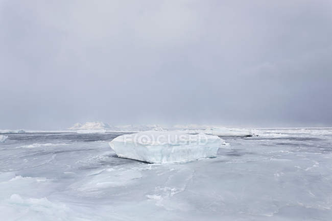 Sheet of glacial ice on frozen lake — Stock Photo