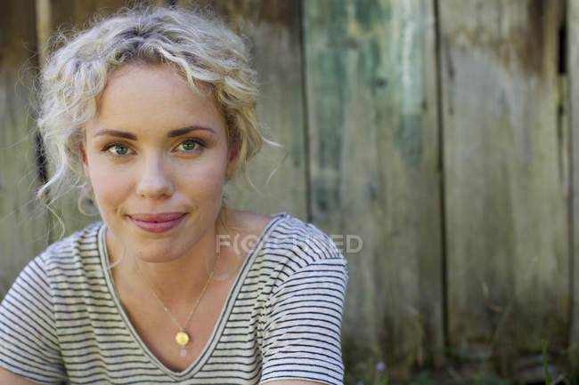 Portrait of pretty blonde woman looking at camera — Stock Photo