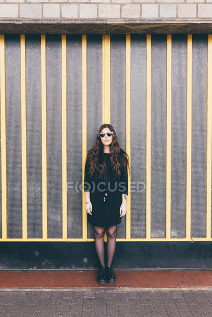 Portrait of young woman, in urban environment — Stock Photo