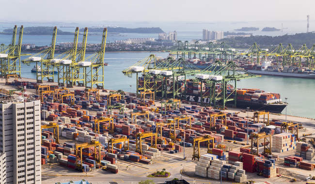 Elevated view of container terminal, cranes and container ship, Singapore, South East Asia — Stock Photo