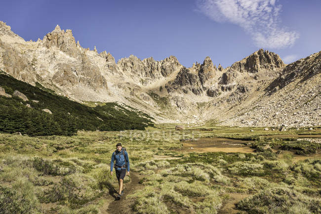 Male hiker trekking in mountain valley, Nahuel Huapi National Park, Rio Negro, Argentina — Stock Photo